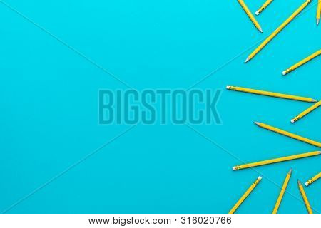 Top View Photo Of Yellow Sharpened Pencils Over Turquoise Blue Background With Copy Space. Flat Lay