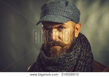 Fashionable Demi-season Clothing. Stylish Man Wrapped In Scarf. Handsome Beardedman Wearing Winter C