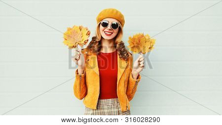 Autumn Warm Portrait Young Smiling Woman With Yellow Maple Leaves In French Beret Over Gray Wall Bac