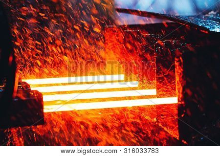 Plant For The Production Of Steel. An Electric Melting Furnace. Factory Worker Takes A Sample For Me