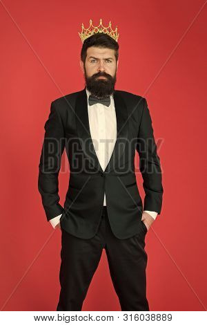 Royalty In His Blood. Formal Wear Male Fashion. Egoist. Businessman In Tailored Tuxedo And Crown. Bi