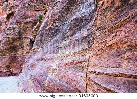 multicoloured sandstone walls of gorge Siq in Petra Jordan poster