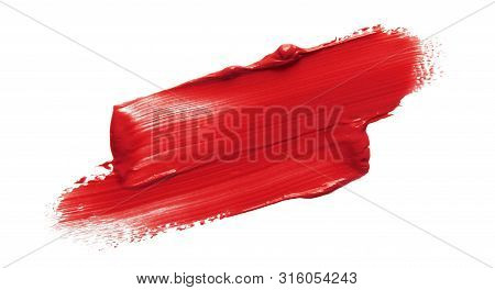 Lipstick Smear Smudge Swatch Isolated On White Background. Cream Makeup Texture. Bright Red Color Co
