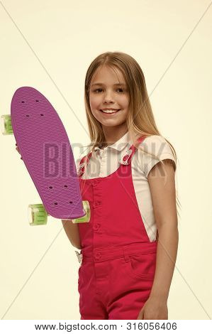 Little Girl With Penny Board. Girl Skater With Penny Skateboard. Little Hipster Skateboarder. Cute H