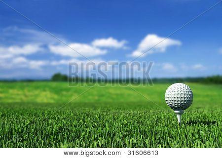 Golf Ball On Tee On The  Green Grass