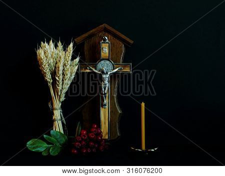 Branch Of Mountain Ash, Wheat Ears, Crucifix With Wood Inlay (souvenir) And Candle On Black Backgrou