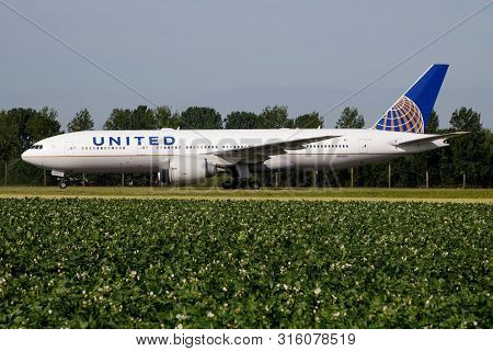Amsterdam / Netherlands - July 3, 2017: United Airlines Boeing 777-200 N78003 Passenger Plane Taxiin