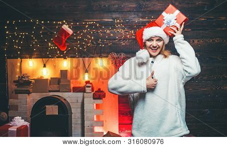 Christmas Woman. Winter Holidays And People Concept. Merry Christmas. Winter Woman Wearing Red Santa