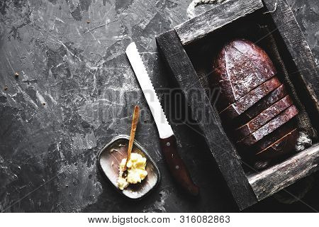 Bread In An Old Wooden Box Already Cut Into Pieces. Food A