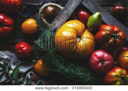 Fresh Tomatoes In An Old Box. On Wooden Background. A