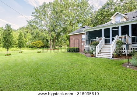 Colonial Brick House With Covered Back Porch With Large Yard