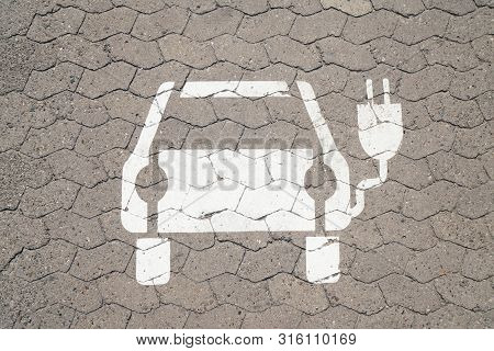Electric Car Charging Station Pictogram Symbol Painted On Parking Space - E-mobility Concept