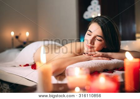 Spa, Massage. A Young Dark-haired Beautiful Girl Is Waiting For A Massage.