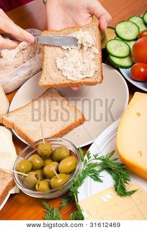 Spreading Tuna Spread On Sandwich