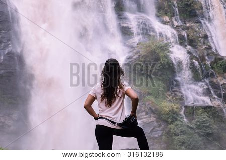 Beautiful Woman At Big Waterfall After Hiking In Chiang Mai (thailand) With Copy Space