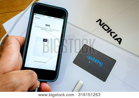Paris, France - Sep 7, 2018: Update In Progress Mesage On Phone Setup Process Of New Nokia Withings