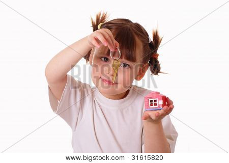 Little Girl Holds A Key In Her Hand