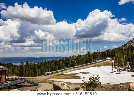 Enclosed Conveyor Ski Lift At Ski Resort In Springtime