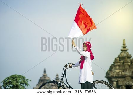 Asian Hijab Flapper Indonesian Flag In Bicycle, Indonesian Independence Day