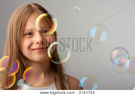 The Happy Girl And Flying Bubbles
