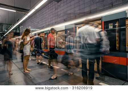 Prague, Czech Republic,23 July 2019; People At Metro Station Entering Subway Train, Long Exposure Te