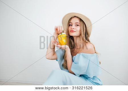 Young Beautiful Girl Holding Fresh Yellow Pepper