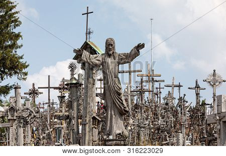 Pilgrims On The Hill Of Crosses