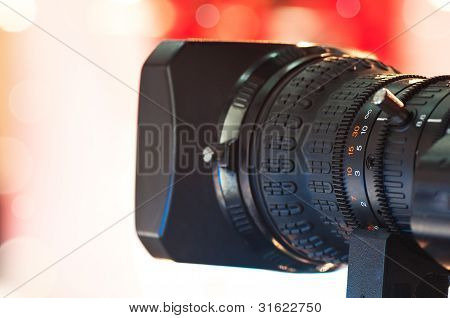 Close-up of professional digital video camera lens poster