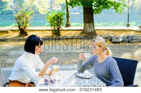 True Friendship Friendly Close Relations. Trust Her. Female Friends Sit In Coffee Shop And Enjoy Tal