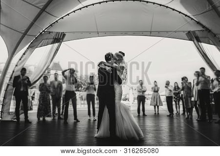 Stylish Happy Bride And Groom Gently Dancing At Wedding Reception. Gorgeous Wedding Couple Of Newlyw