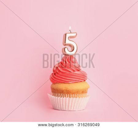 Birthday Cupcake With Number Five Candle On Pink Background