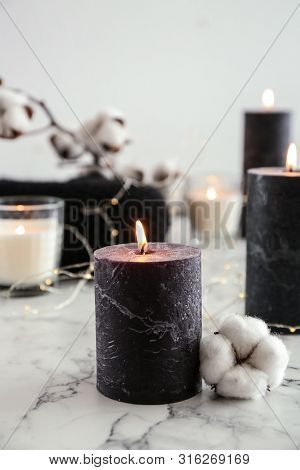 Burning Candles And Cotton Flower With Fairy Lights On Marble Table, Space For Text