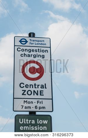 London, Uk - July 16, 2019:congestion Charge Charging Central Zone Sign Against Blue Sky. The Road I
