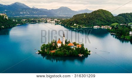 Bled, Slovenia. Aerial Drone View Of Lake Bled With The Pilgrimage Church Of The Assumption Of Maria