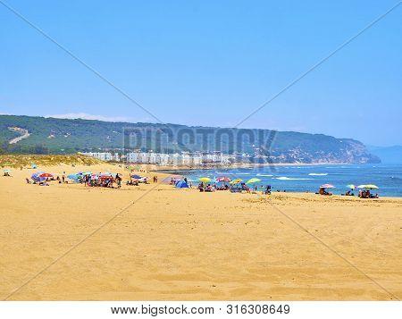 Barbate, Spain - June 26, 2019. People Enjoying A Sunbathing In The Playa De Los Caños De Meca Beach