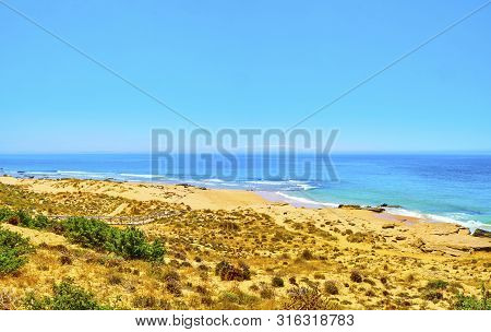 Panoramic View Of The Faro De Trafalgar Beach, A Broad Beach Of Fine Sand Dunes Of The Cabo De Trafa