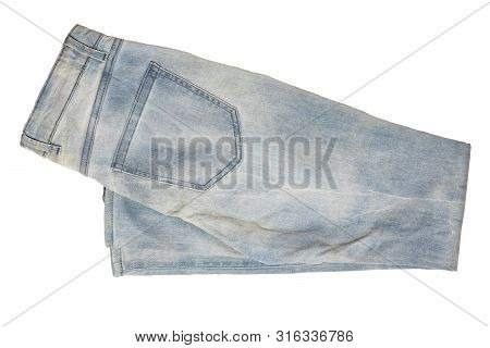 Woman Jeans Isolated. Folded Trendy Stylish Female Blue Jeans Trousers Isolated On A White Backgroun