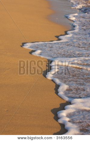 Beach Shoreline Waves In The Early Morning Sun
