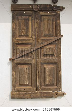 Old Window With Shutters On The Wooden Wall.