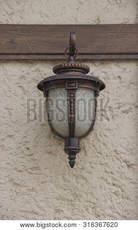 The Ancient Street Lamp On The Wall.