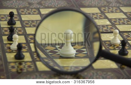 The Figure Is Viewed Through A Magnifying Glass. Choosing The Best Candidate. The Concept Management