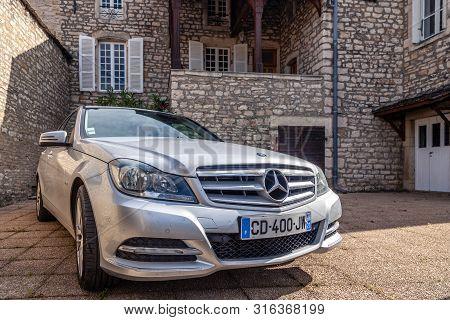 France Lyon 2019-06-20 Closeup Luxury Silver German Car Sedan Premium Mercedes C Class With Eu Regis