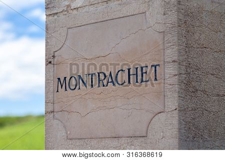 France Burgundy 2019-06-20 Closeup Old Stone Pillows With Vintage Plate, Nameboard Of Montrachet Gra