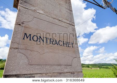 France Burgundy 2019-06-20 Closeup Stone Pillows With Vintage Plate, Nameboard Of Montrachet Grand C