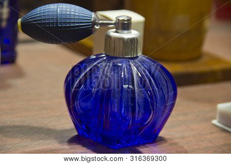 The Old Perfume Bottle With Rubber Spray.