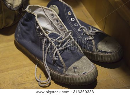 The Two Old, Worn Sneakers With Laces.