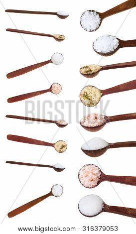Set From Little Dark Brown Wooden Salt Spoon With Various Salts Isolated On White Background