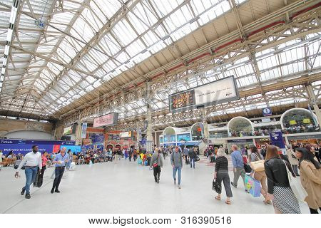 London England - May 31, 2019: Unidentified People Travel At Victoria Train Railway Station London E