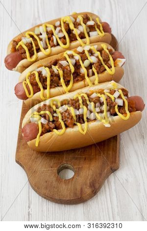 Homemade Detroit Style Hot Dogs On A Rustic Wooden Board On A White Wooden Background, Low Angle Vie
