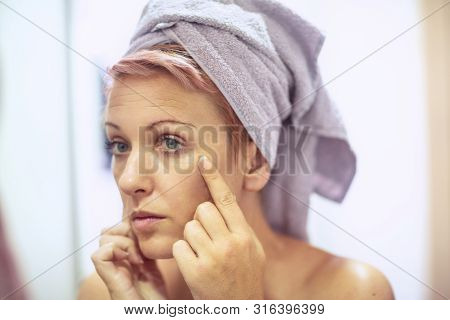 Anti-wrinkles Care Concept- Young Girl Is Worried About The Wrinkles On Her Face.
